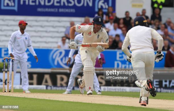 England's Alastair Cook sets off for a run with his batting partner Mark Stoneman on the first day of the second international Test match between...
