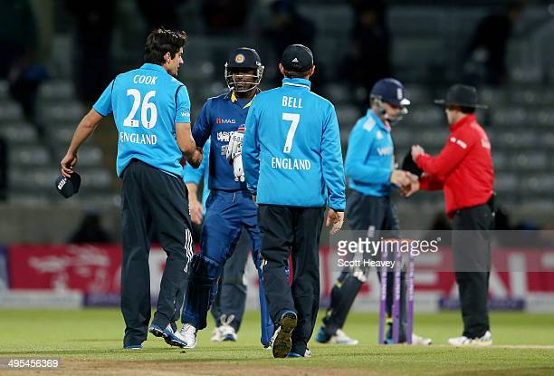 England's Alastair Cook shakes hands with Angleo Matthews after the match during the 5th ODI Royal London One Day International at Edgbaston on June...