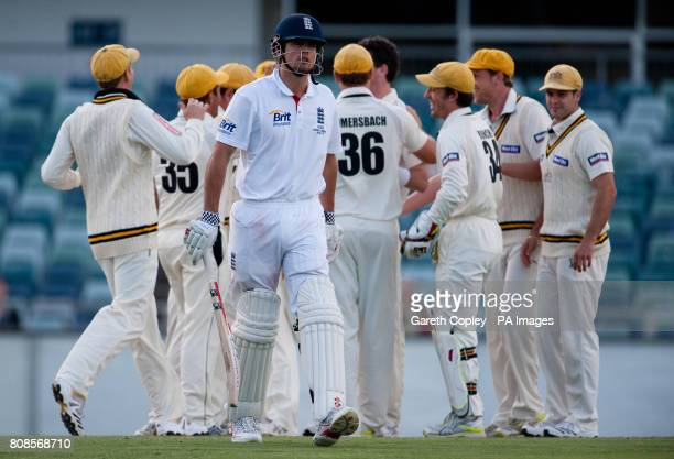 England's Alastair Cook walks off dejected after being bowled by Western Australia's Steve MaGoffin during the tour match at the WACA Perth