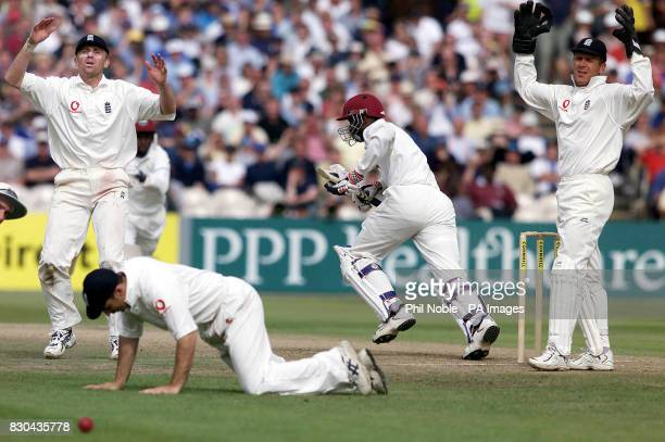 England's Alec Stewart and Dominic Cork can't hide their disapointment as captain Nasser Hussain fails to hold a chance from West Indies openerAdrian...