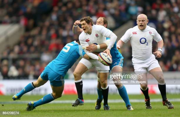 England's Alex Goode is tackled by Italy's Andrea Massi and Sergio Parisse during the RBS Six Nations match at Twickenham London