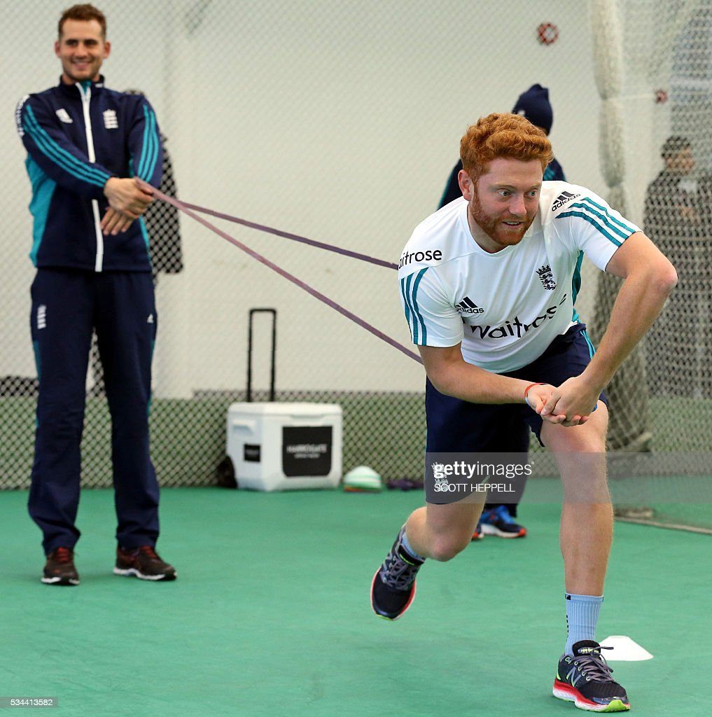 England's Alex Hales (L) and England's Jonny Bairstow use bands as they take part in an indoor practise session ahead of the second cricket Test match between England and Sri Lanka in Chester-le-Street, north east England on May 26, 2016. England may come into the second Test against Sri Lanka in Durham on the back of a crushing win in the series opener, but according to Stuart Broad the hosts have still to hit top form. England are set to play Sri Lanka in a second test cricket match on May 27. / AFP / SCOTT