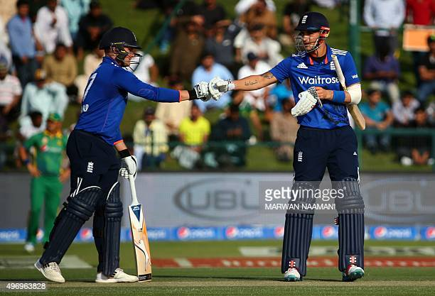 England's Alex Hales gestures towards his teammate Jason Roy after running between the wickets during the second One Day International match during...