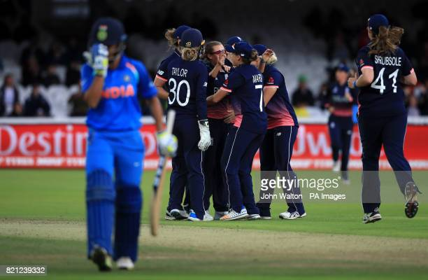 England's Alex Hartley celebrates the wicket of India's Sushma Verma with teammates during the ICC Women's World Cup Final at Lord's London