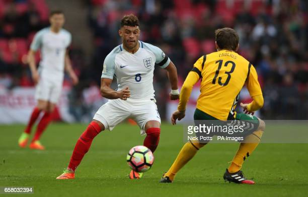 England's Alex OxladeChamberlain and Lithuania's Simonas Paulius battle for the ball during the World Cup Qualifying match at Wembley Stadium London