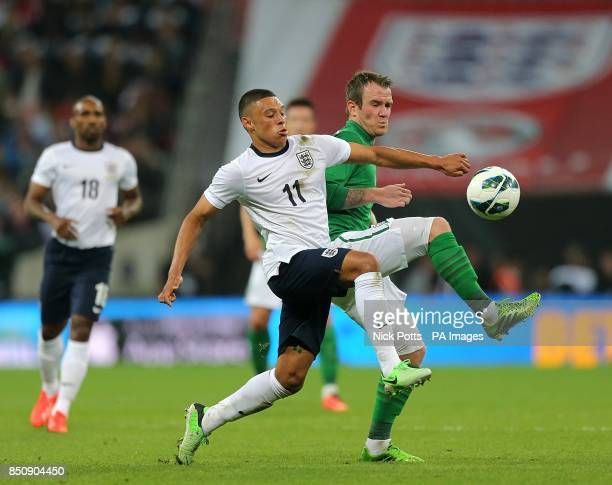 England's Alex OxladeChamberlain and Republic of Ireland's Glenn Whelan battle for the ball