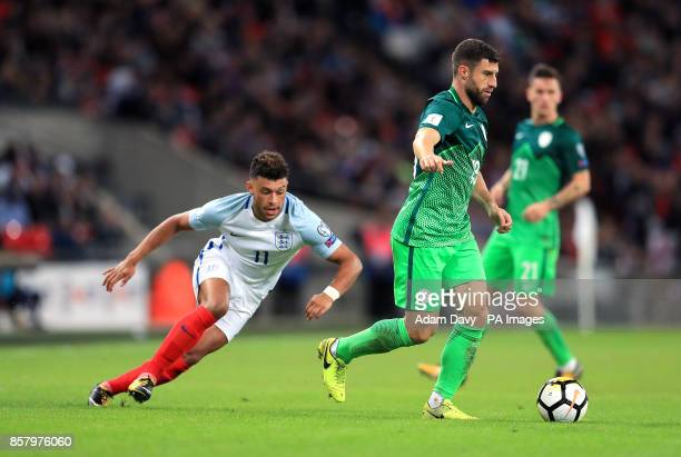 England's Alex OxladeChamberlain and Slovenia's Bojan Jokic battle for the ball during the 2018 FIFA World Cup Qualifying Group F match at Wembley...