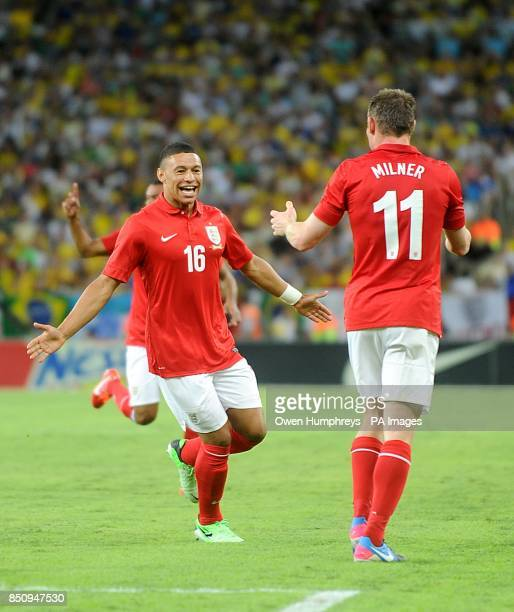 England's Alex OxladeChamberlain celebrates scoring their first goal of the game with teammate James Milner