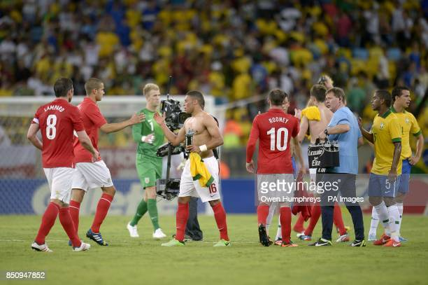 England's Alex OxladeChamberlain embraces teammates after the final whistle