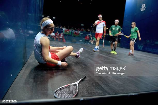 England's Alison Waters laughs after dropping her racket with Peter Barker against Wales's Peter Creed and Tesni Evans during their mixed doubles...