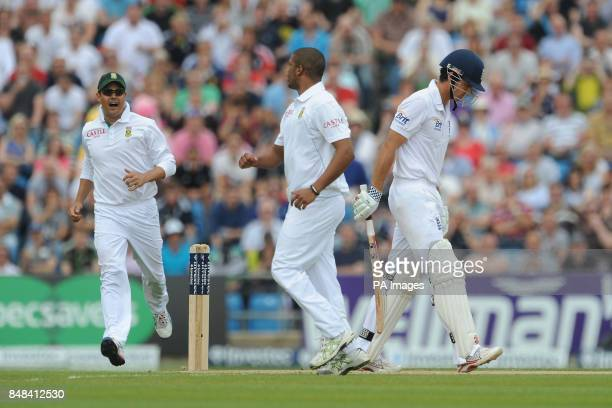 England's Alistair Cook leaves the field after being dismissed lbw by South Africa's Vernon Philander during the Investec Second Test match at...
