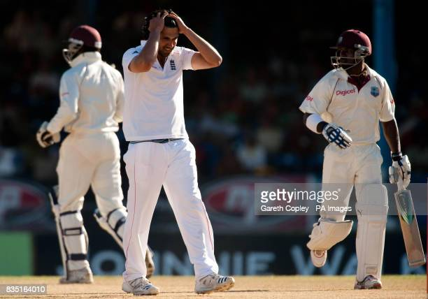 England's Amjad Khan holds his head after bowling his first ball during the fifth test at Queen's Park Oval Port of Spain Trinidad