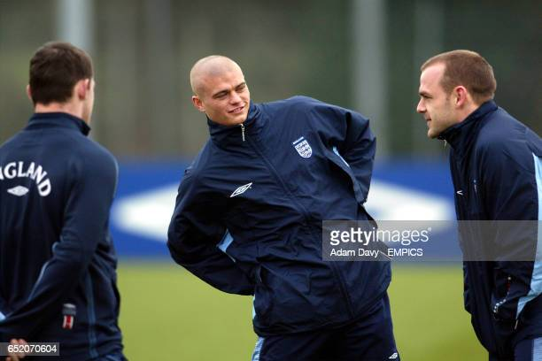 England's and Charlton Athletic's Paul Konchesky chats to Wayne Rooney and Danny Murphy