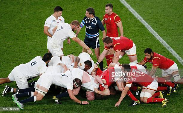 England's and Wales' players vie in a scrum during a Pool A match of the 2015 Rugby World Cup between England and Wales at Twickenham stadium south...