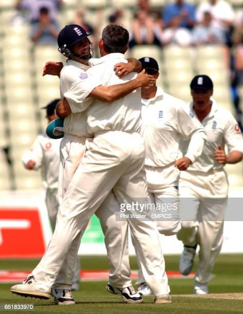 England's Andrew Caddick is hugged my Michael Vaughnn after taking the wicket of Sri Lanka's Hashan Tillakaratne