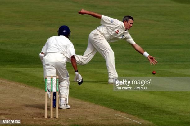 England's Andrew Caddick lets the travel past him off India's Sanjay Bangar