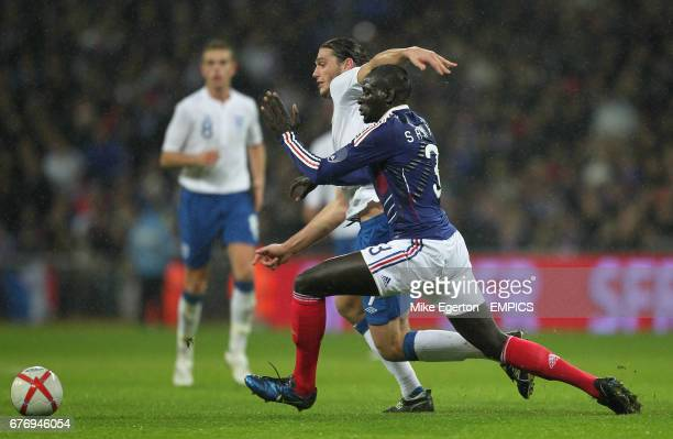 England's Andrew Carroll and France's Mamadou Sakho battle for the ball