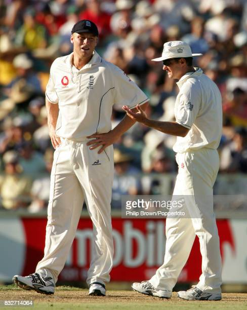 England's Andrew Flintoff and Andrew Strauss discuss tactics during Australia's second innings of the 3rd Test match between Australia and England at...