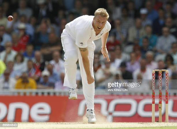 England's Andrew Flintoff bowls on the second day of the fifth and final Ashes cricket Test match between England and Australia at the Brit Oval in...