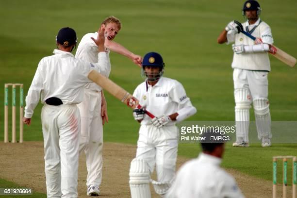 England's Andrew Flintoff celebrates his dismissal of India's Sanjay Bangar caught behind by Alec Stewart