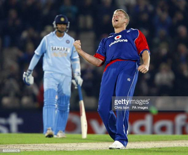 England's Andrew Flintoff celebrates the wicket of India's Mahendra Singh Dhoni as Rahul Dravid looks on during the NatWest Series match at the Rose...