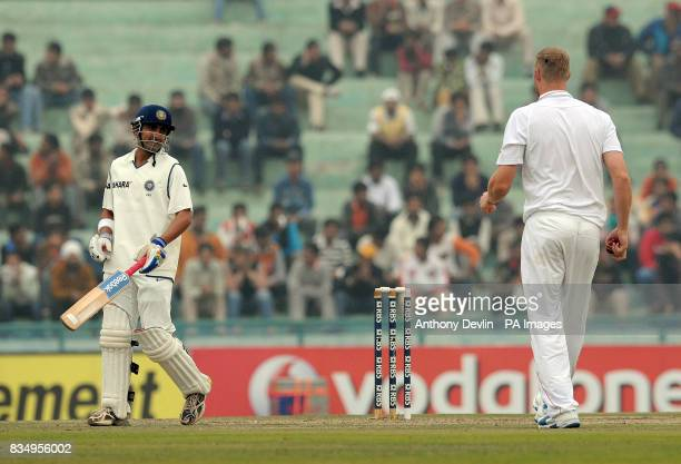 England's Andrew Flintoff exchanges words with Gautam Gambhir during the second day of the second test at the Punjab Cricket Association Stadium...