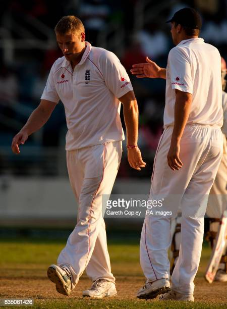 England's Andrew Flintoff is patted on the back by Steve Harmison after his bowling spell during the First Test at Sabina Park Kingston Jamaica