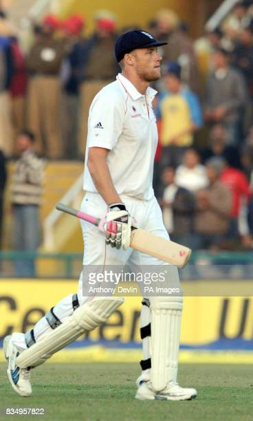 England's Andrew Flintoff leaves the field after being caught by Gautam Gambhir off the bowling of Amit Mishra for 62 during the third day of the...
