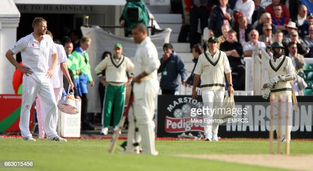 England's Andrew Flintoff looks on as umpire Billy Bowden recalls South Africa's Hashim Amla to the field
