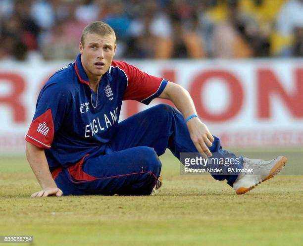 England's Andrew Flintoff sits dejected after failing to take a catch off his own bowling during the ICC Champions Trophy match at the Sardar Patel...