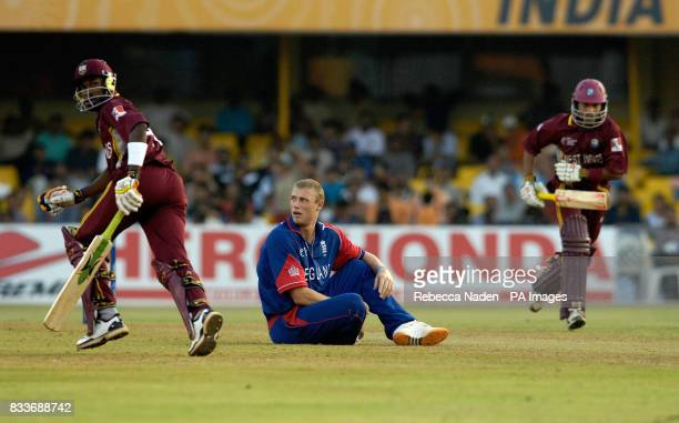 England's Andrew Flintoff sits dejected as West Indies' Dwayne Bravo and Ramnaresh Sarwan score runs during the ICC Champions Trophy match at the...