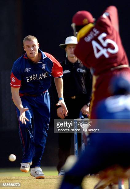 England's Andrew Flintoff stops a run off his own bowling during the ICC Champions Trophy match against the West Indies at the Sardar Patel Stadium...