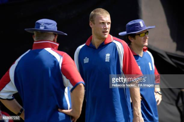 England's Andrew Flintoff with Duncan Fletcher and bowling coach Kevin Shine during a nets practice session at the Sardar Patel Stadium Ahmedabad...