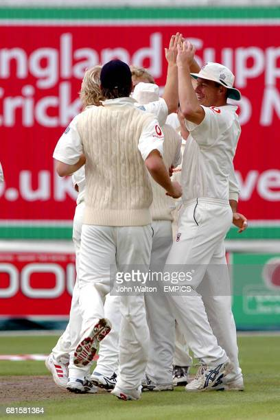 England's Andrew Strauss celebrates with bowler Matthew Hoggard after they dismiss West Indies Chris Gale for 5