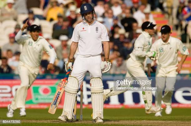 England's Andrew Strauss hangs his head after being caught out by New Zealand wicketkeeper Brendon McCullum for 60 runs during the Second npower Test...