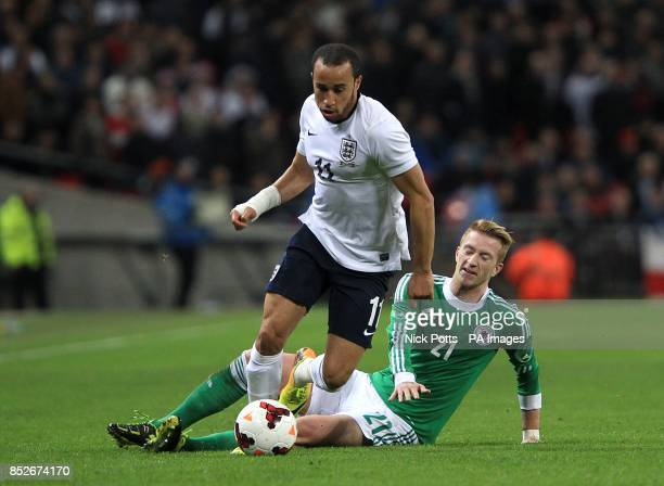 England's Andros Townsend and Germany's Marco Reus battle for the ball