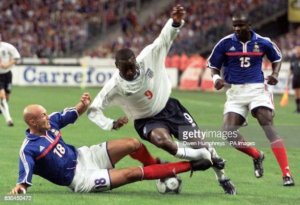 LEAGUE England's Andy Cole is tackled by France's Frank Leboeuf during their friendly international football match at the Stade de France Paris