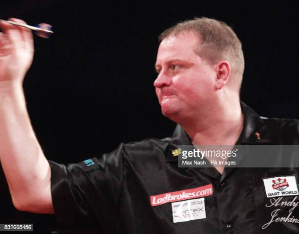 England's Andy Jenkins against Raymond van Barneveld during the semifinal of the PDC Ladbrokescom World Championships at Purfleet Essex