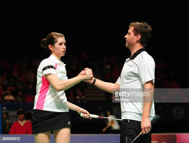 England's Anthony Clark and Heather Olver shake hands after losing against Korea's Yong Dae Lee and Hyo Jung Lee during the Yonex All England Open...