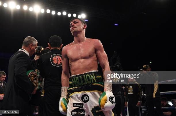 England's Anthony Crolla walks to his corner following his unanimous decision loss to Venezuela's Jorge Linares in their WBA WBC Diamond Ring...