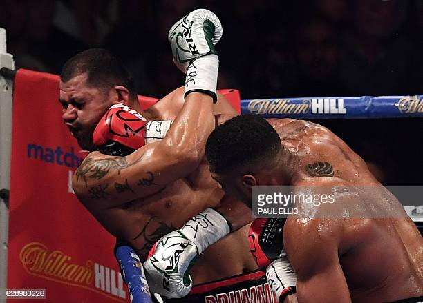TOPSHOT England's Anthony Joshua delivers the winning punch against USA's Eric Molina during the IBF World Heavyweight Championship boxing match in...