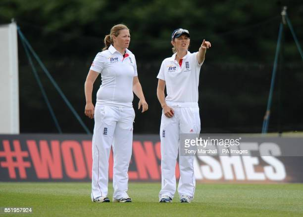 England's Anya Shrubsole and Charlotte Edwards decide on their field placing during day four of the First Women's Ashes test match at Wormsley...