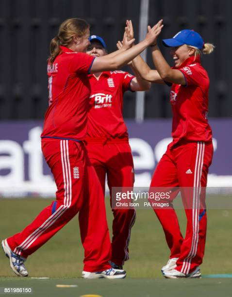 England's Anya Shrubsole and Danielle Hazell celebrate combining to takie the wicket of Australia's Alyssa Healey for no runs during the One Day...