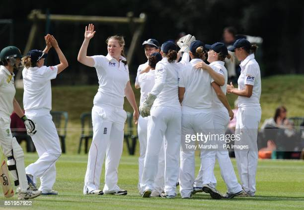 England's Anya Shrubsole celebrates after Arran Brindle catches out Australia's Meg Lanning during day four of the First Women's Ashes test match at...