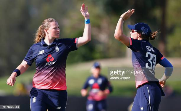 England's Anya Shrubsole celebrates the wicket of Australia's Ellyse Perry during the Women's International One Day match between Australia and...