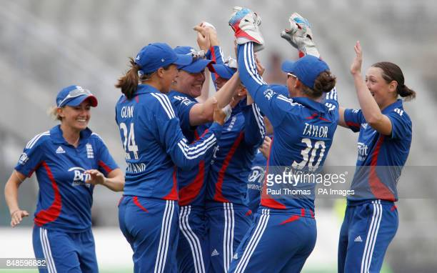 England's Anya Shrubsole celebrates with team mates after taking a catch to dismiss West Indies' Deandra Dottin during the NatWest Women's...