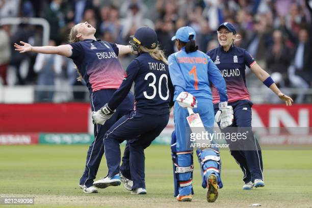 England's Anya Shrubsole celebrates with teammates as she takes the wicket of India's Rajeshwari Gayakwad to win the ICC Women's World Cup cricket...
