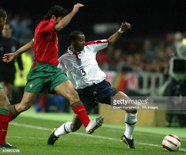 England's Ashley Cole and Portugal's Luis Figo during the international friendly match at the Algarve Stadium Faro Portugal THIS PICTURE CAN ONLY BE...