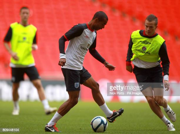 England's Ashley Cole and Tom Cleverley during a training session at Wembley Stadium London