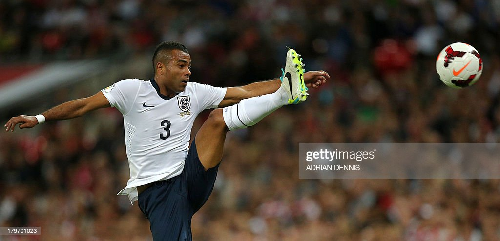 England's Ashley Cole jumps for the ball against Moldova during the World Cup 2014 Group H qualifying football match between England and Moldova at Wembley Stadium in north London, on September 6, 2013.